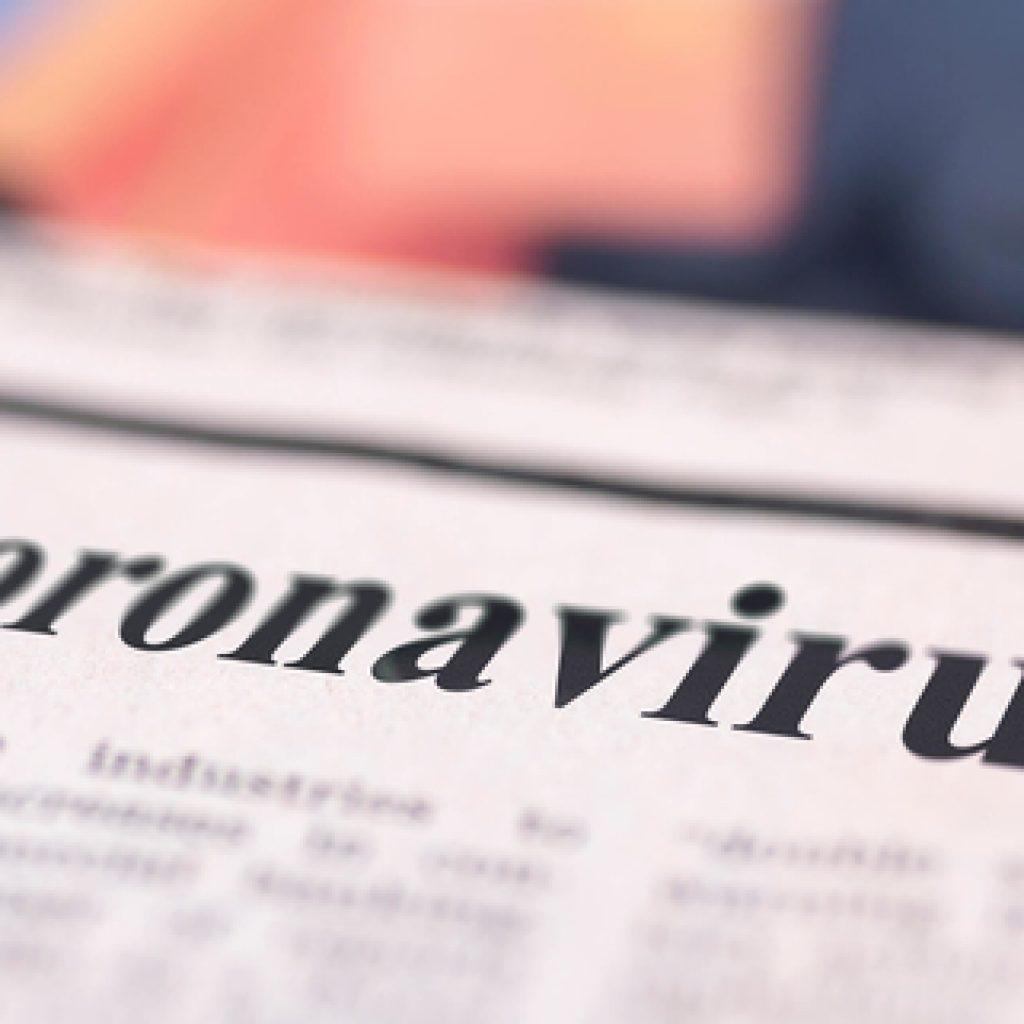 Krantenkop met coronavirus