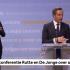 Gebarentolk Irma Sluis en coronaminister Hugo de Jonge tijdens de persconferentie