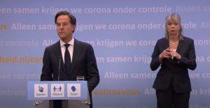 foto van persconferentie met Mark Rutte en gebarentolk
